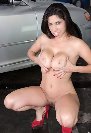 Sexy lady wearing high heels is practicing wild sex with her partner on the big expensive car. He is acting like a real fucking machine.