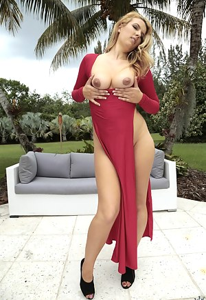 Awesome lady is taking her sexy red dress with great pleasure. She is touching her naked body and enjoying passionate sex with her man.