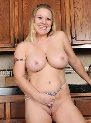 Busty 30 year old MILF Allyza Blue gets down and dirty in the kitchen
