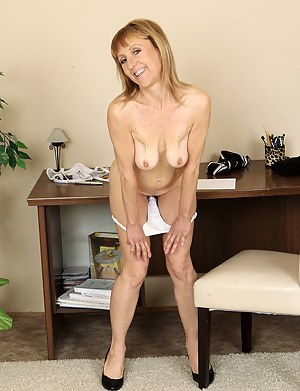 Cute 49 year old steno Tina M in her office puts on a sexy strip show