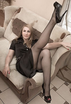 Luiza M is in her black dress and stockings. She reclines on her chair and slowly undresses. She has a sexy ass, perfect hairy pussy and body. She loves to show it off as she bends over and more.