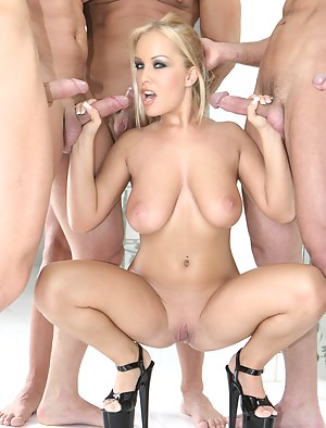 Five passionate men are pleasing lovely blonde having natural tits. They are drilling her mouth with their penises for a long time.