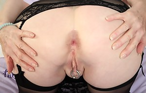 Kinky pierced British housewife playing alone