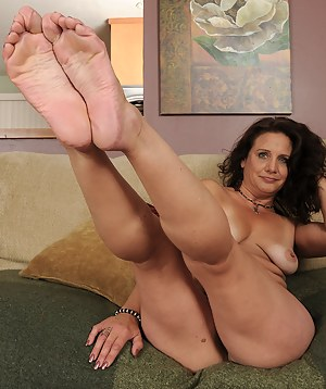 43 year old MILF Chane strips and then starts playing with her feet