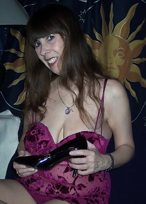 here i am wearing one of my favorite purple dresses..i had just startedto shave my lil kitty and this shows me with all