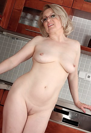 Margeaux from AllOver30 spreads her legs and pussy in the kitchen