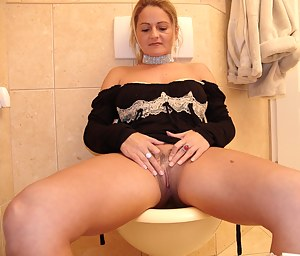 This MILF loves sucking cock and eat ass on the toilet