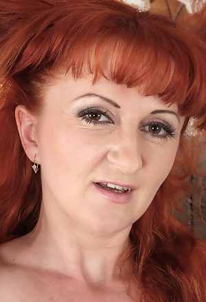 Red headed MILF Trixi from AllOver30 shows off her naturally hairy pussy
