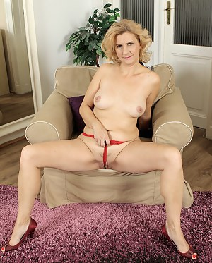 43 year old Katriss from AllOver30 pulls her pussy wide on the couch
