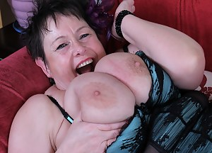 Big Breasted British mature lady fooling around