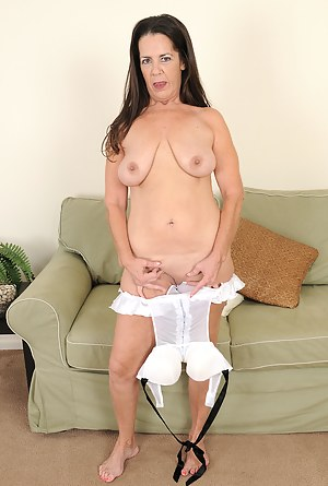 Horny 51 year old Tia slips out of her white lingerie and spreads wide