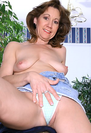 47 year old Lynn pulling her white panties aside in here