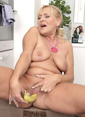 Horny mature Sissy fucks a banana