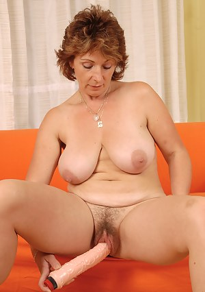 Mature Misti slips her large dildo deep inside her 42 year old pussy