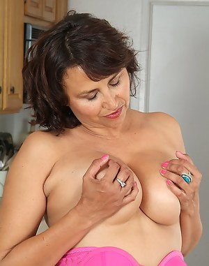 Busty housewife with a furry pussy gives us a peek up close