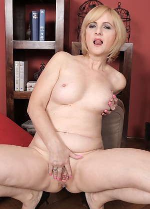 Classy blonde Jennyfer B strips down and shows that sexy mature body