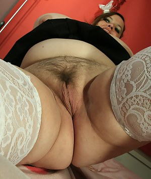 Big mama with big tits playing with her pussy