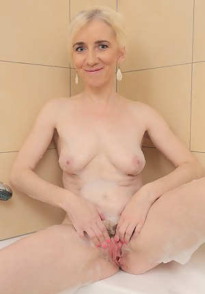 Petite blonde 48 year old Dorena gets her mature pussy wet in here