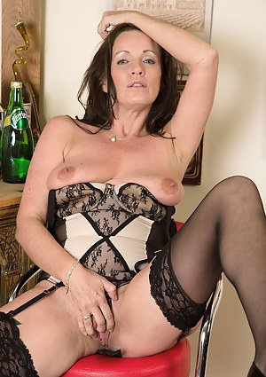 Beautiful brunette Marlyn from AllOver30 slips out of her elegant dress