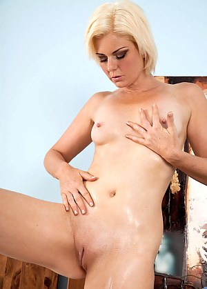 Gorgeous milf Rebecca caresses her mature pussy to make herself cum