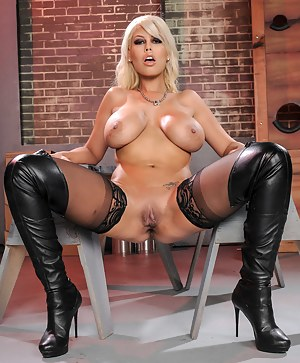 Sexy blonde with massive melons is looking sexy wearing black stockings and boots. Her man is making her happy banging her so hard.