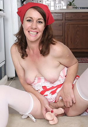 Horny 41 year old housewife Molly Golly fucks her toy in the kitchen