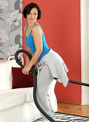Nothing like a little housework to get this brunette MILF hot and horny