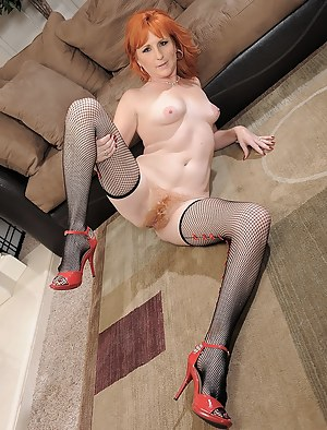Welcome to the group sex party this redhead MILF wearing sexy stockings is enjoying with her two lovers presenting her with double penetration.