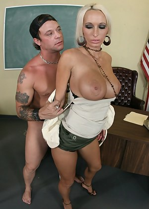 Tanned and short-haired blonde teacher finds out that her student is working, which is not surprising considering he's in his 40s, ends up fucking him.
