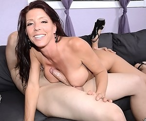 Busty lady having big fake tits is enjoying sensational fuck session with her lover. She is getting her juicy holes penetrated with his big penis.