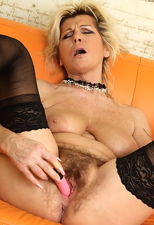Berna slips a pink dildo into her 52 year old hot and furry pussy