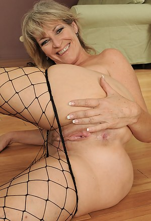 49 year old Tina from AllOver30 looking fantastic in her fishnet stockings