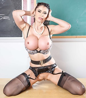 Two brutal guys are banging the busty brunette wearing black stockings in the classroom. They are covering her wonderful face with loads of jizz.