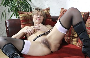 Lovely housewife playing on the couch