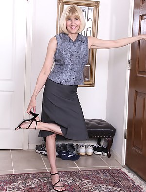 Horny business woman Bossy Ryder strips after work.