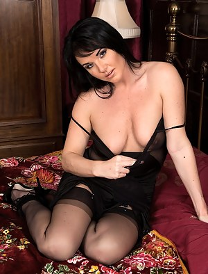 Sexy mature babe Danielle Leah Raven naked in black stockings.