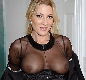 Meet this gorgeous blonde MILF wearing black leather suit. She is touching her own big tits when demonstrating her great cowgirl skills.
