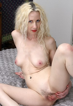Blonde MILF Lilly stabs at her mature pussy with her vibrating friend