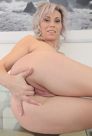 39 year old Kathy White from AllOver30 squatting on her rubber friend