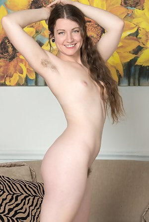 Mahonia is 25, and enjoys reading and getting naked. She finishes on her sofa and strips naked. She shows her hairy pits and full hairy pussy. She isn't shy, and shows everyone how hairy she is today.