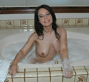 Solo posing from an excellent amateur beauty with big tits, who pleases herself in the bathroom fingering that sweet shaved pussy.