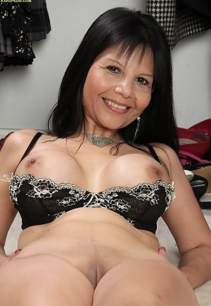 Busty cougar Marcy Darling spreads her older pussy.