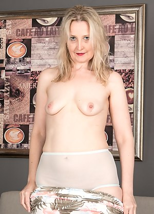Blonde wife Emma Turner hikes her dress and spreads her pussy.
