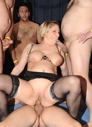 Two horny German housewives are the centre of a gang bang
