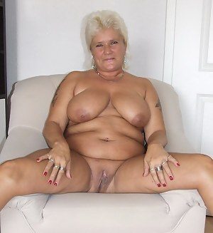 Blonde chubby mature slut showing off her rack