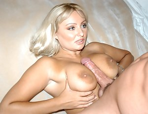 Watch how a busty MILF is teasing her hard nipples and exposes her big tits while doing a first class blowjob to her tanned lover.
