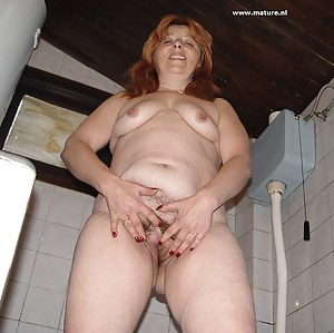 Horny housewife playing with a banana and getting piss