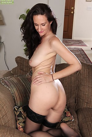 Sexy cougar Genevieve Crest exposes big floppy tits.