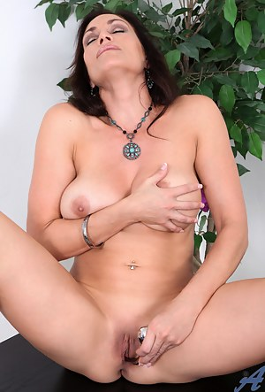 Busty hot milf pleasures her craving snatch with a metal wand