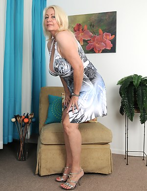 Horny 60 year old Angelique from AllOver30 tugs at her mature box